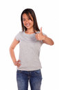 Asiatic charming young woman showing you ok sign portrait of an on blue jeans and gray t shirt against white background Royalty Free Stock Photos