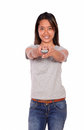 Asiatic female pointing at you with remote control Royalty Free Stock Photo