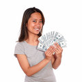 Asiatic young woman holding cash money portrait of an while is looking at you against white background Royalty Free Stock Photography