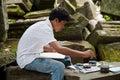 Asiatisk pojkemålarfärg en till salu bild Arkivbilder