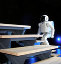 Asimo robot walking Royalty Free Stock Image