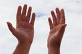 Ask for help from god a man raises his hands up to soft focus Stock Image
