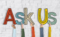 Ask us concepts on brick wall Stock Image