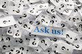 Ask us question marks on white papers hard light Stock Photos