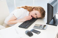Asleep businesswoman yawning on keyboard at office young resting head while in the Stock Photo