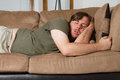 Asleep couch hard day Stock Photography