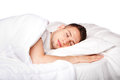 Asleep and dreaming man handsome young happily sleeping in white bed isolated Royalty Free Stock Photos