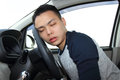 Asleep at the wheel a young man falling steering Royalty Free Stock Photos