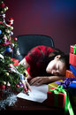 Asleep with wish list to Santa Royalty Free Stock Image