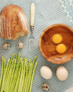 Asparagus, bread and quail eggs and chicken eggs broken Royalty Free Stock Photo