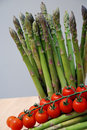 Asparagus with cherry tomatoes Stock Photography