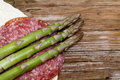 Asparagus mature on a wooden base Royalty Free Stock Photos