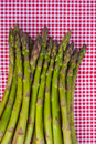 Asparagus on red napkin pile of Royalty Free Stock Photos