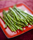 Asparagus on a red plate Royalty Free Stock Photography