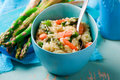 Asparagus and Shrimp Risotto in  blue dish Royalty Free Stock Photo