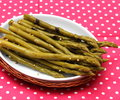 Asparagus some uncooked green on a plate Stock Image