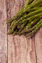 Asparagus spears on a rustic background close up Stock Image