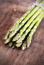Asparagus spears with shallow depth of field on a rustic wooden table Stock Image