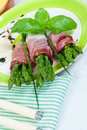 Asparagus with speck Stock Photos