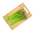 Asparagus stalks on wood cutting board Royalty Free Stock Photo