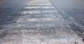 Asphalt crosswalk on a city street Royalty Free Stock Photo
