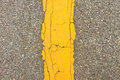 Asphalt dark texture with yellow lines Stock Photos