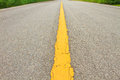 Asphalt dark texture with yellow lines Royalty Free Stock Photo