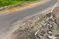 Asphalt demolished pavement surface on both sides of the street was due to poor construction Royalty Free Stock Photo