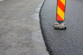 Asphalt layer old and new layerwith trtaffic sign Royalty Free Stock Image