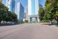Asphalt pavement with modern urban background