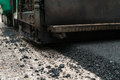 Asphalt paving machine running on road work Royalty Free Stock Photography