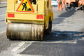Asphalt paving works with compactor Stock Photo