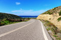 Asphalt road along coast greek island rhodes Stock Photos