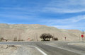 Asphalt road in Atacama desert Royalty Free Stock Photo