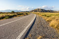 Asphalt road going to the mountains with separating strips Royalty Free Stock Photography