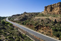 Asphalt road leading into the distance in lesotho mountains Stock Image