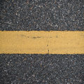 Asphalt road with marking lines. Close-up background texture Royalty Free Stock Photo