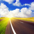 Asphalt road over blue sky Royalty Free Stock Photo