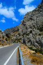 Asphalt road in rocky canyon Stock Photography