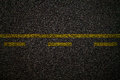 Asphalt road texture yellow line on Royalty Free Stock Photos
