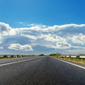 Asphalt road to horizon cloudy Stock Photos