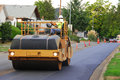 Asphalt roller large vibrating compactor working on an repaving project in roseburg oregon Royalty Free Stock Photo