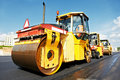 Asphalt roller at work Stock Images
