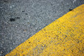 Asphalt yellow and black the paint on the road close up Stock Images