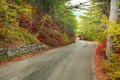 Asphalted mountain road through autumn forest Royalty Free Stock Photo