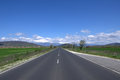 Asphalted road and the blue sky image of in bulgaria at foot of balkan mountain stara planina Stock Photo