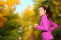 Aspirations aspirational woman runner running looking and thinking about future goals female athlete jogging in autumn forest in Stock Images