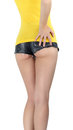 Ass woman wearing a short denim shorts jeans with yellow tank top Stock Image