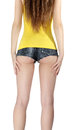 Ass woman wearing a short jeans shorts with yellow tank top Royalty Free Stock Photo