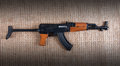 Assault rifle an on a hessian background Royalty Free Stock Image